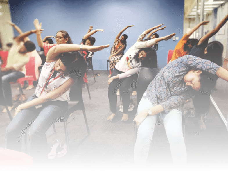 Group of women participating in a chair yoga class, Mumbai.